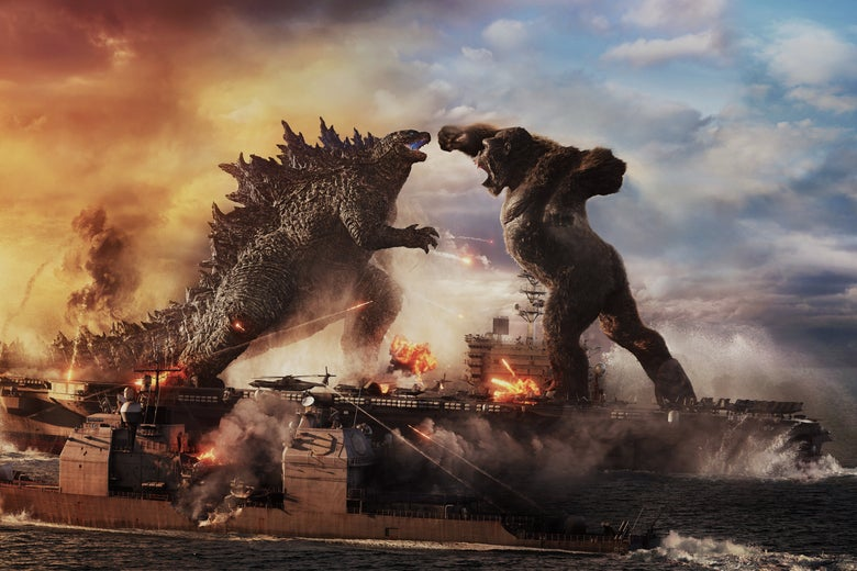 A still from Godzilla vs. Kong, showing Godzilla and King Kong squaring off atop an aircraft carrier on the open sea. Kong is throwing a roundhouse punch at Godzilla's face.