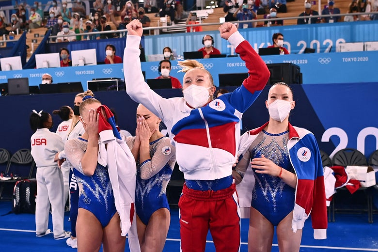 The four Russian gymnasts cry and cheer after learning that they won the gold medal