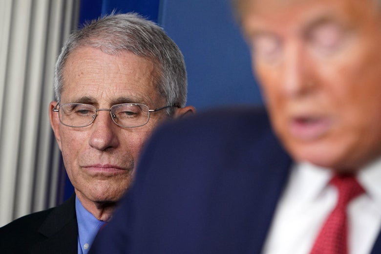 President Donald Trump, flanked by Director of the National Institute of Allergy and Infectious Diseases Anthony Fauci, speaks during the daily briefing on the novel coronavirus, COVID-19, in the Brady Briefing Room at the White House on March 25, 2020, in Washington, D.C.