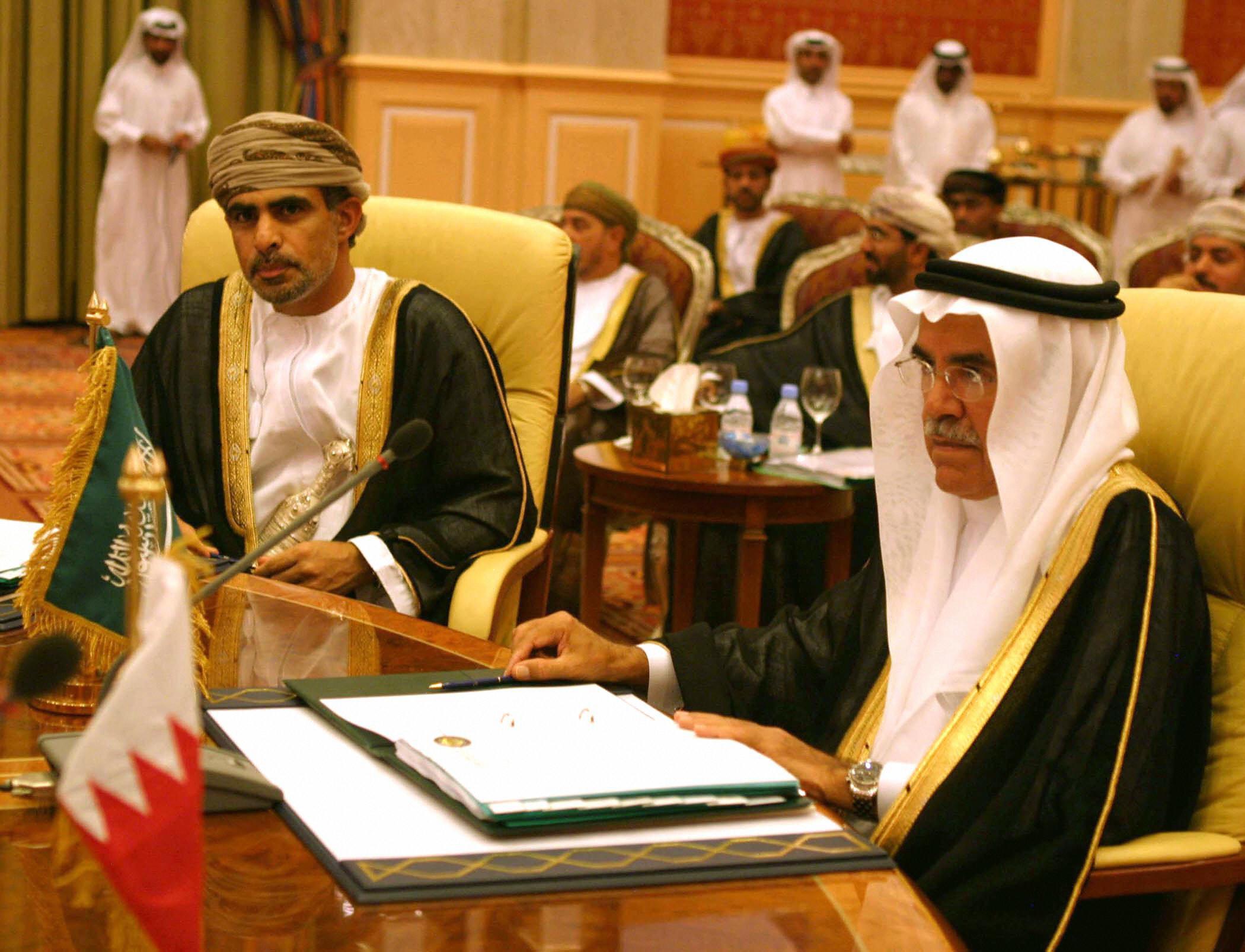 Saudi's Oil Minister Ali al-Nuaimi, right, sits next to Oman's Oil and Gas minister Mohammad bin Hamad bin Saif al-Romhi.