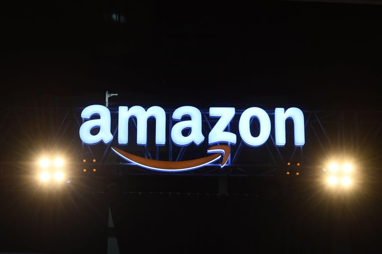 An Amazon logo bookended by bright lights.