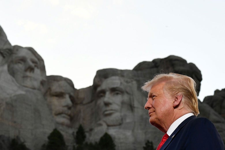 President Donald Trump standing in front of Mount Rushmore.