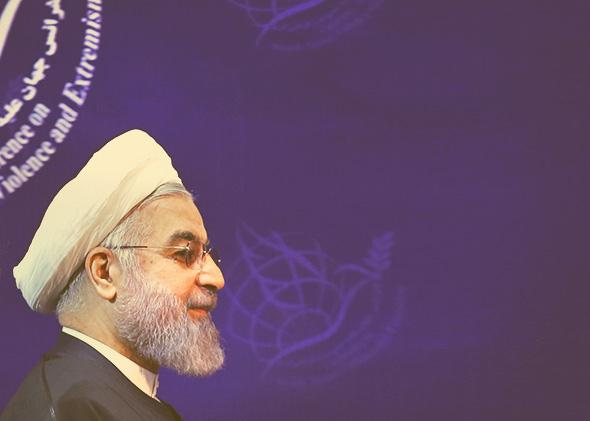 Iran's President Hassan Rouhani opens a two-day conference on combatting extremism on Dec. 9, 2014, in the Iranian capital of Tehran