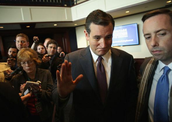 U.S. Senator Ted Cruz (R-TX) waves as he leaves after he addressed the Heritage Action for America's Conservative Policy Summit February 10, 2014 in Washington, DC.