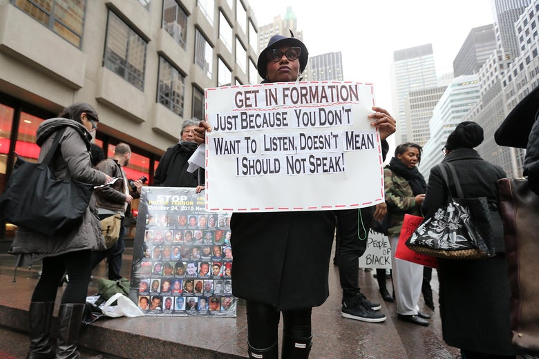 Protestors at the Anti-Anti Beyonce Protest Rally in front of NFL Headquarters on February 16, 2016 in New York City.