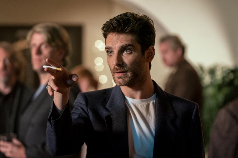 Jeff Ward gestures with a cigarette between his fingers.