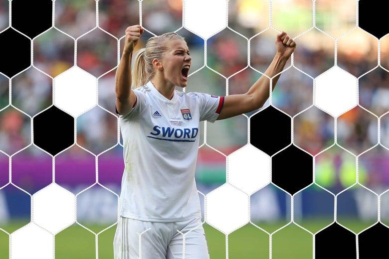 Ada Hegerberg raises her arms in celebration.