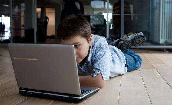 Boy on computer.