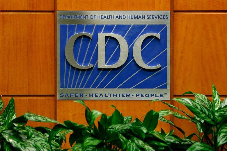 The CDC logo on a podium