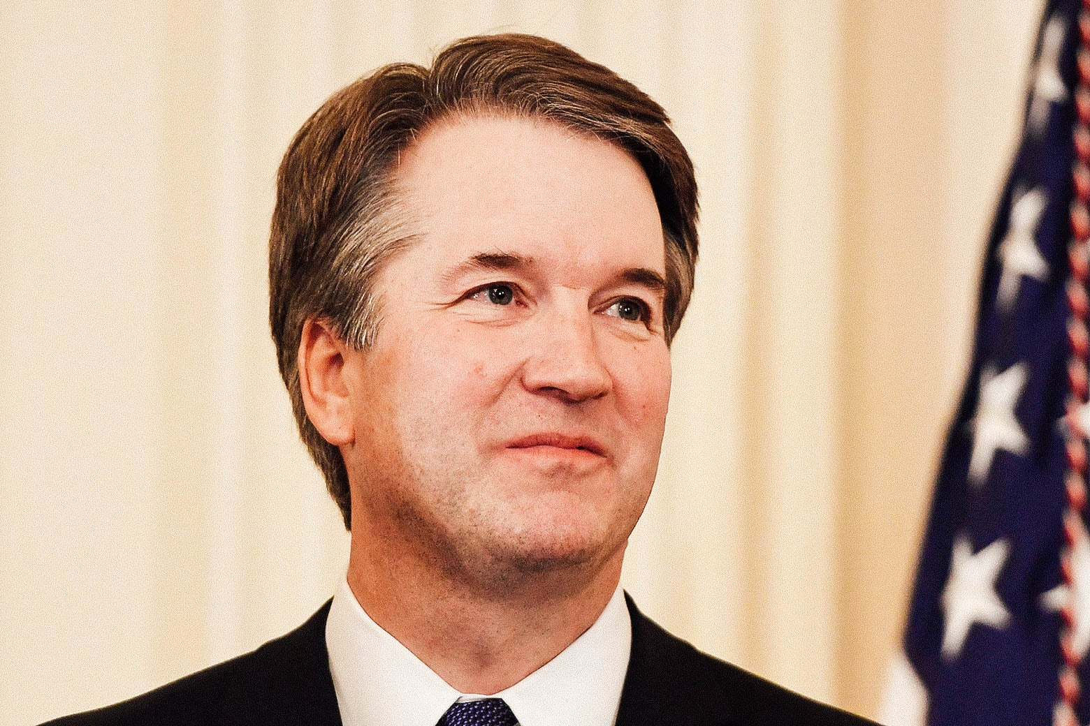 Brett Kavanaugh looks on as Donald Trump announces him as his nominee to the Supreme Court.