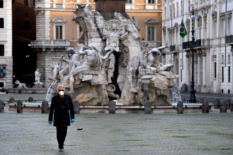 A man walks through an empty square in Rome.