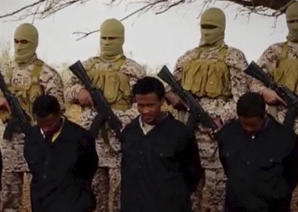 Islamic State militants stand behind what are said to be Ethiopian Christians in Wilayat Fazzan, in this still image from an undated video made available on a social media website on April 19, 2015.