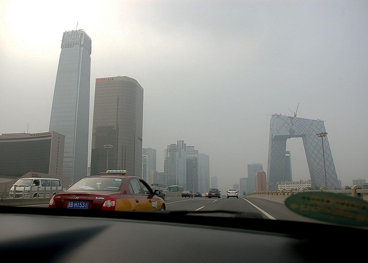 Driving through the smog on the Third Ring Road in Beijing, Chin
