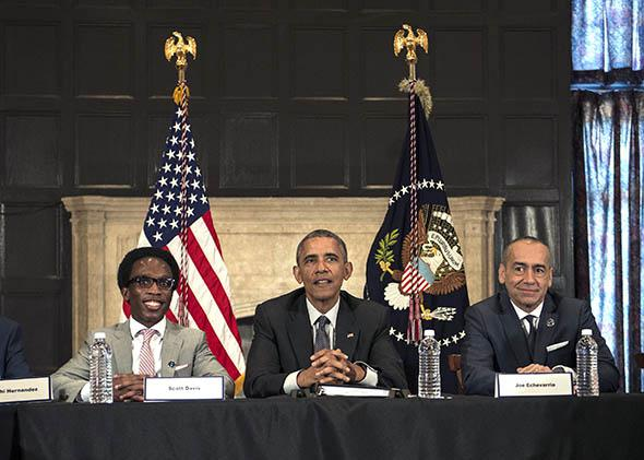 President Barack Obama participates in a roundtable discussion with young people at an event at Lehman College launching the My Brothers Keeper Alliance.