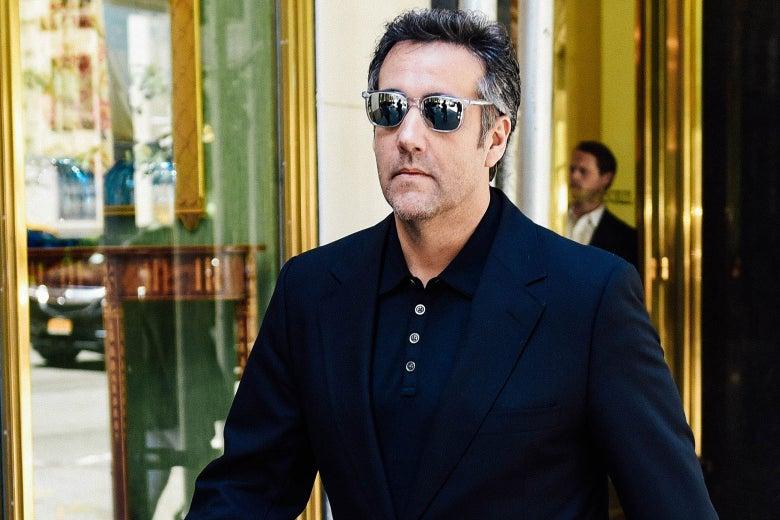 Michael Cohen walks down Park Avenue in sunglasses, a blazer, and a polo.