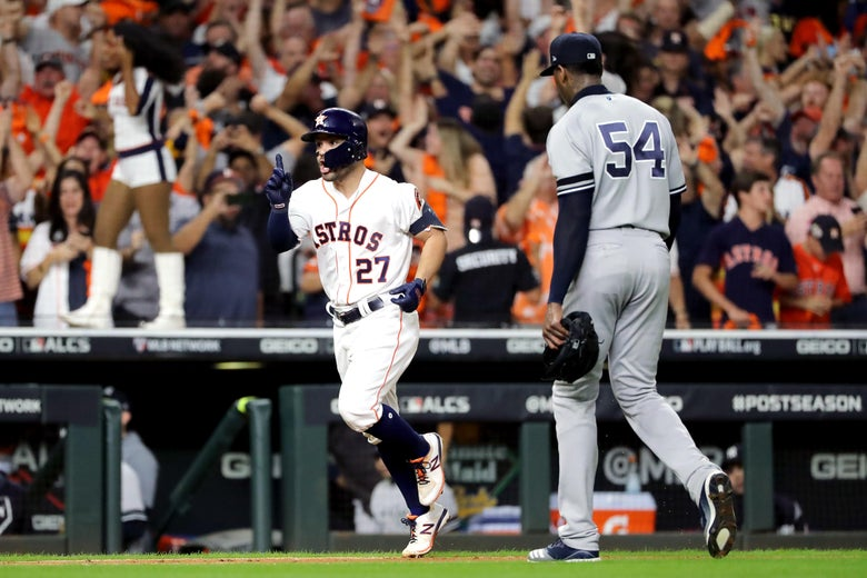 Jose Altuve trots home past Aroldis Chapman after a walk off home run in the 2019 ALCS.