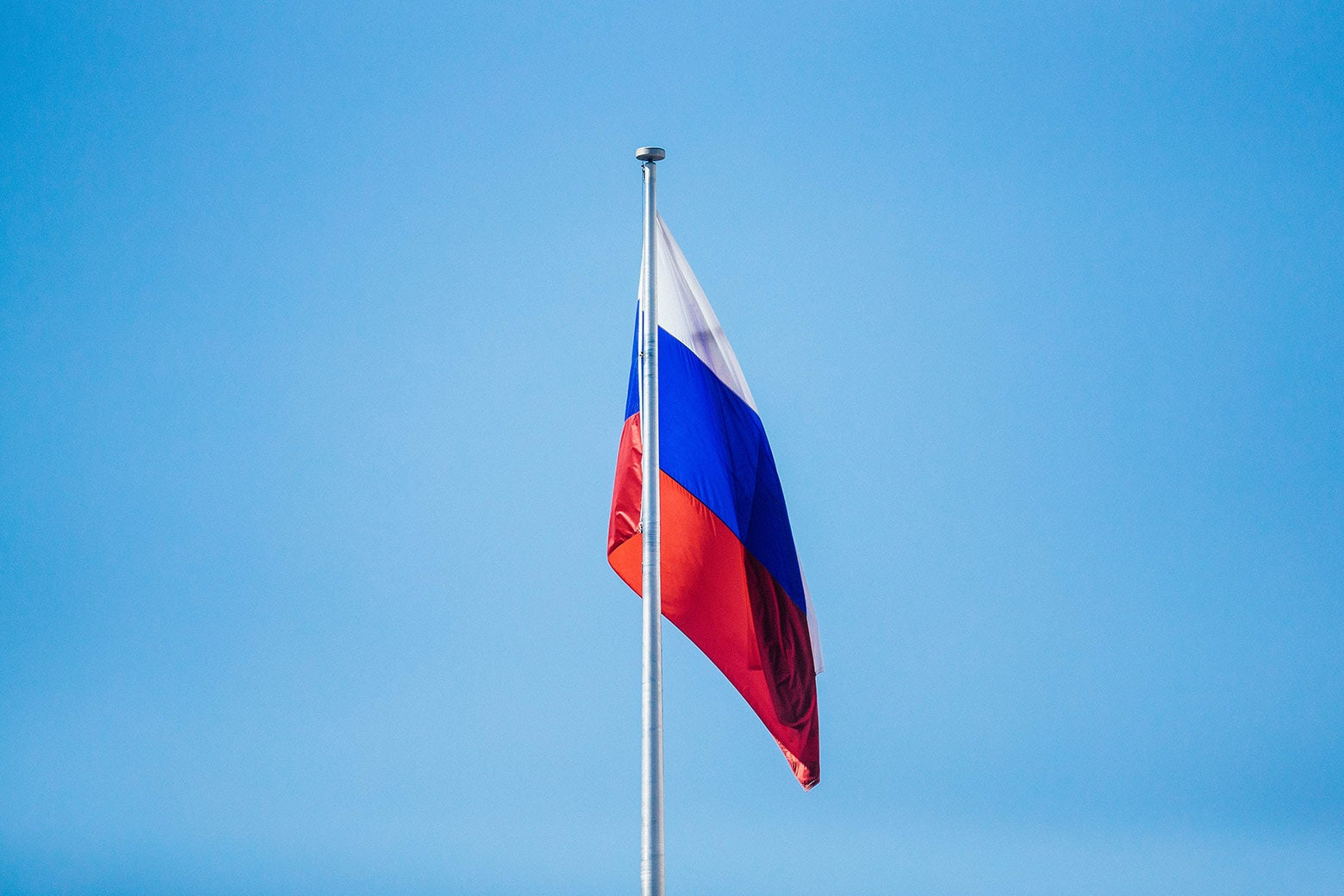 The flag of the Russian Federation flies above the Russian Embassy on March 31 in Washington.