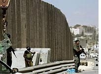 Israeli security barrier. Click image to expand.
