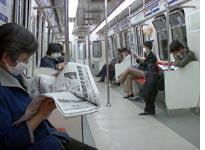 The few, the wary, the masked on the Beijing subway