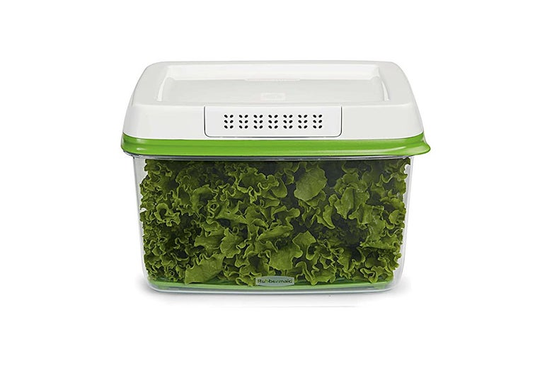 Plastic container full of greens