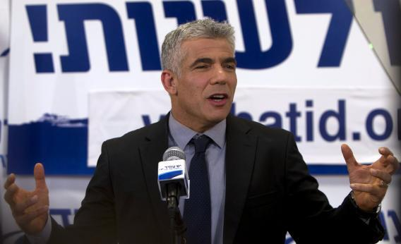 Israeli actor, journalist, and author Yair Lapid, leader of the Yesh Atid Party, speaks to supporters early on Jan. 23, 2013, at party headquarters in Tel Aviv