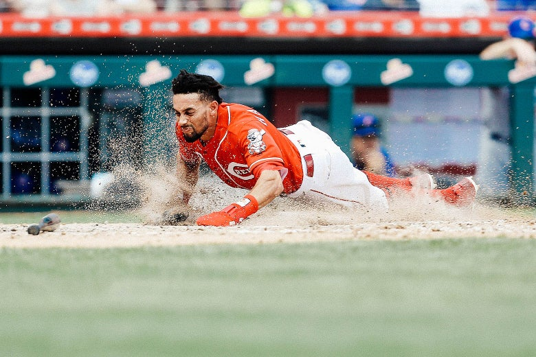 Billy Hamilton slides headfirst into home base.