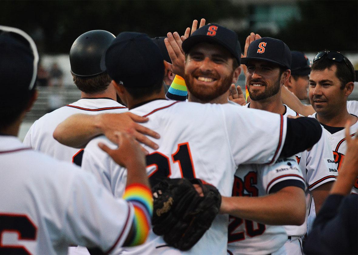 Sean Conroy celebrates with his teammates on Pride Night.