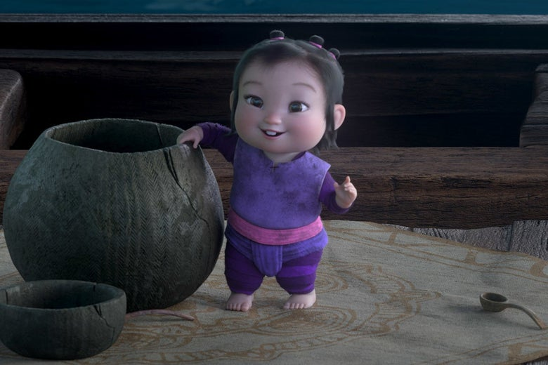 a baby stands next to a large pot