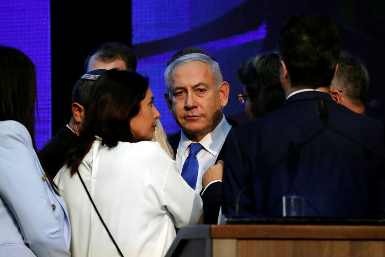 People crowd around Netanyahu at an event.