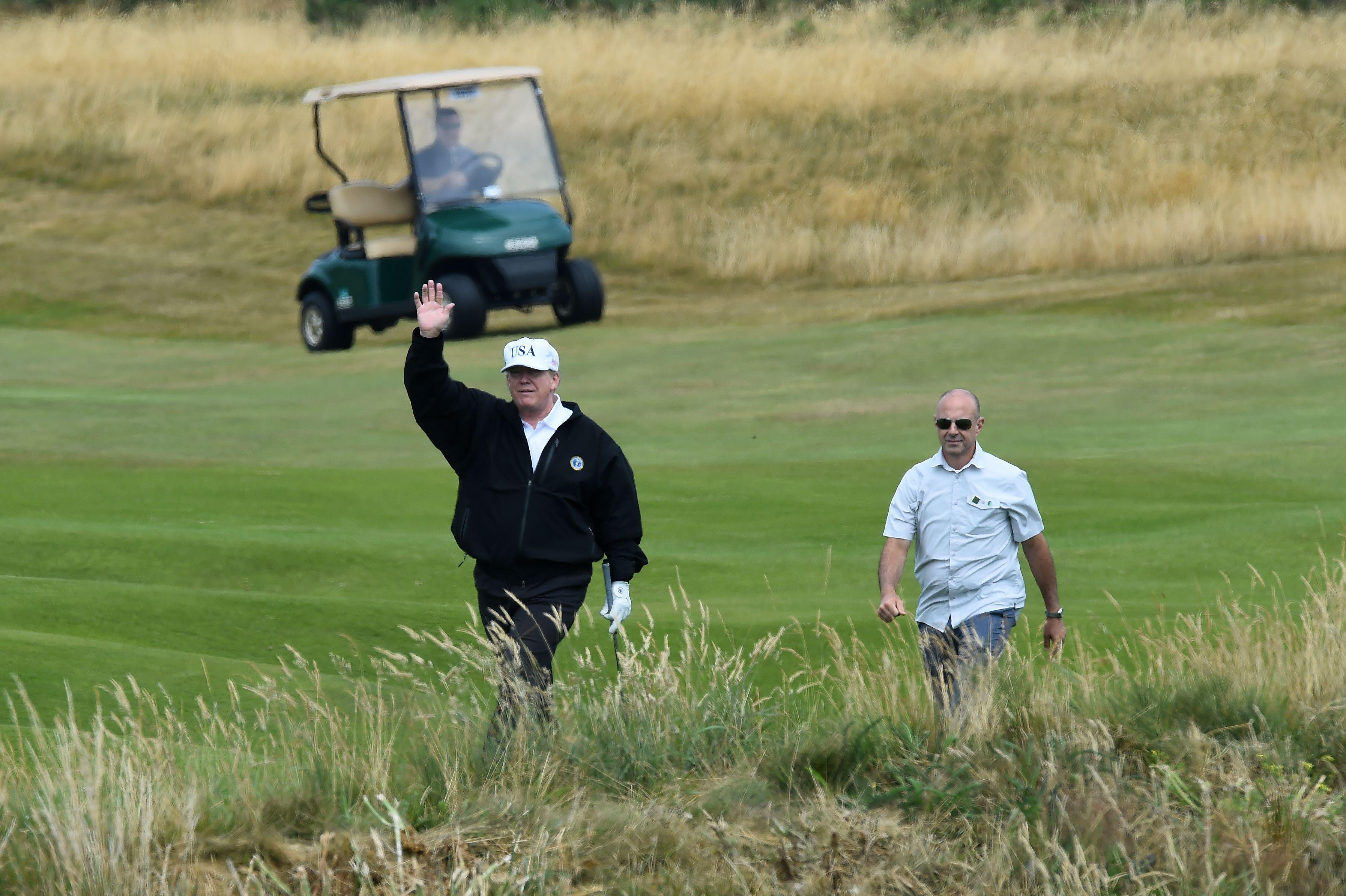President Donald Trump gestures as he plays a round of golf on the Ailsa course at Trump Turnberry, the luxury golf resort of US President Donald Trump, in Turnberry, southwest of Glasgow, Scotland on July 14, 2018.