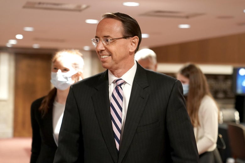 """Former Deputy Attorney General Rod Rosenstein smiles widely as he leaves after a Republican-led Senate Judiciary Committee hearing on  """"Crossfire Hurricane"""", the FBI's probe into Russian election interference and the 2016 Trump campaign in the Dirksen Senate Office Building in Washington, DC,on June 3, 2020."""
