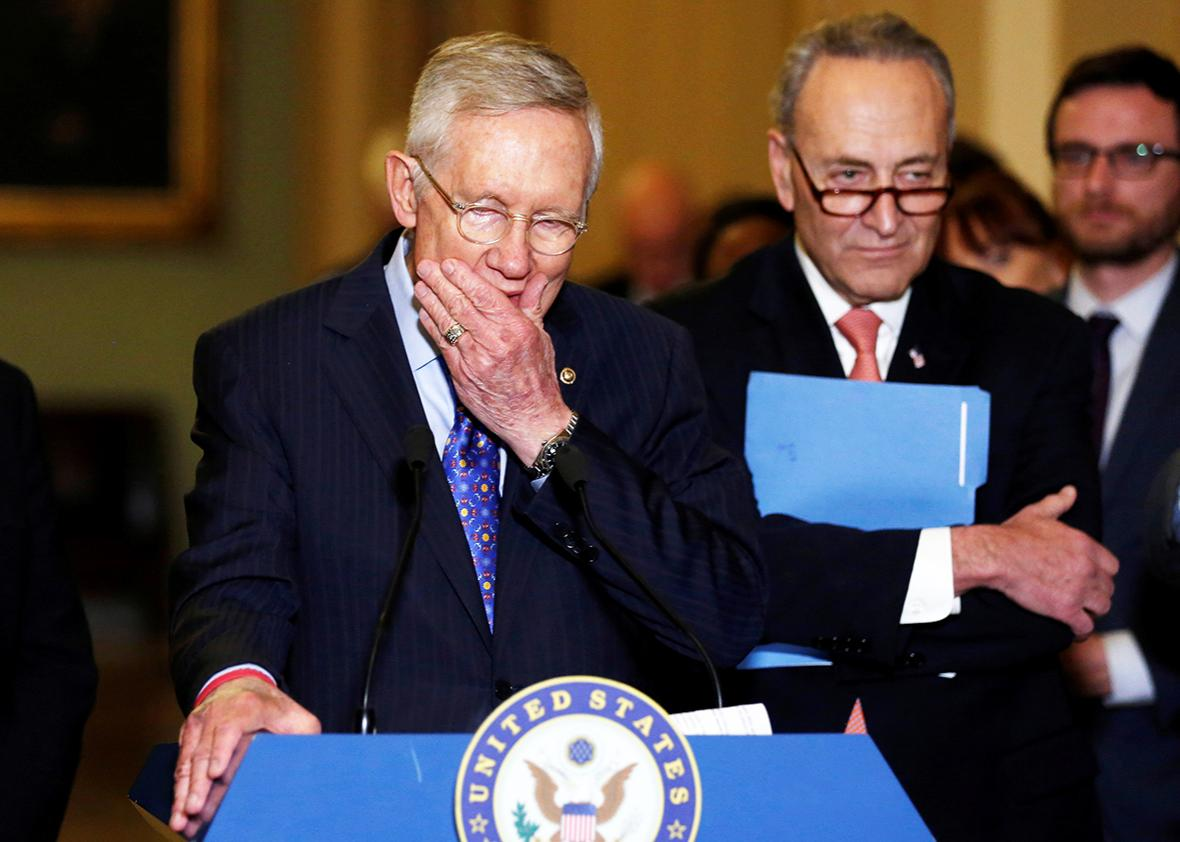 U.S. Senate Minority Leader Harry Reid flanked by Senator Chuck Schumer delivers remarks to reporters after his final weekly Democratic caucus policy luncheon prior to his retirement, at the U.S. Capitol in Washington, U.S. December 6, 2016.