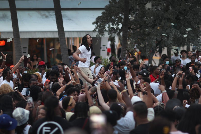 People enjoy themselves along Ocean Drive on March 19, 2021 in Miami Beach, Florida.