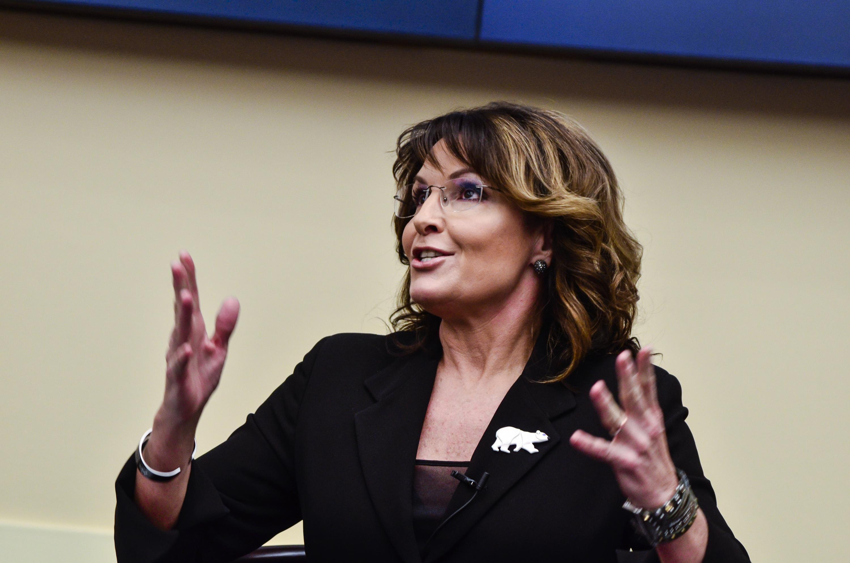 Sarah Palin. She wears a bear pin on her blazer.