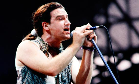 Bono performs with U2 in Paris on July 4, 1987.