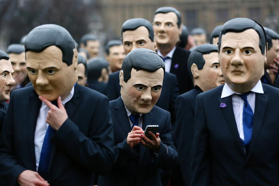 Campaigners dressed as Britain's Chancellor of the Exchequer George Osborne protest in central London on March 19, 2013.