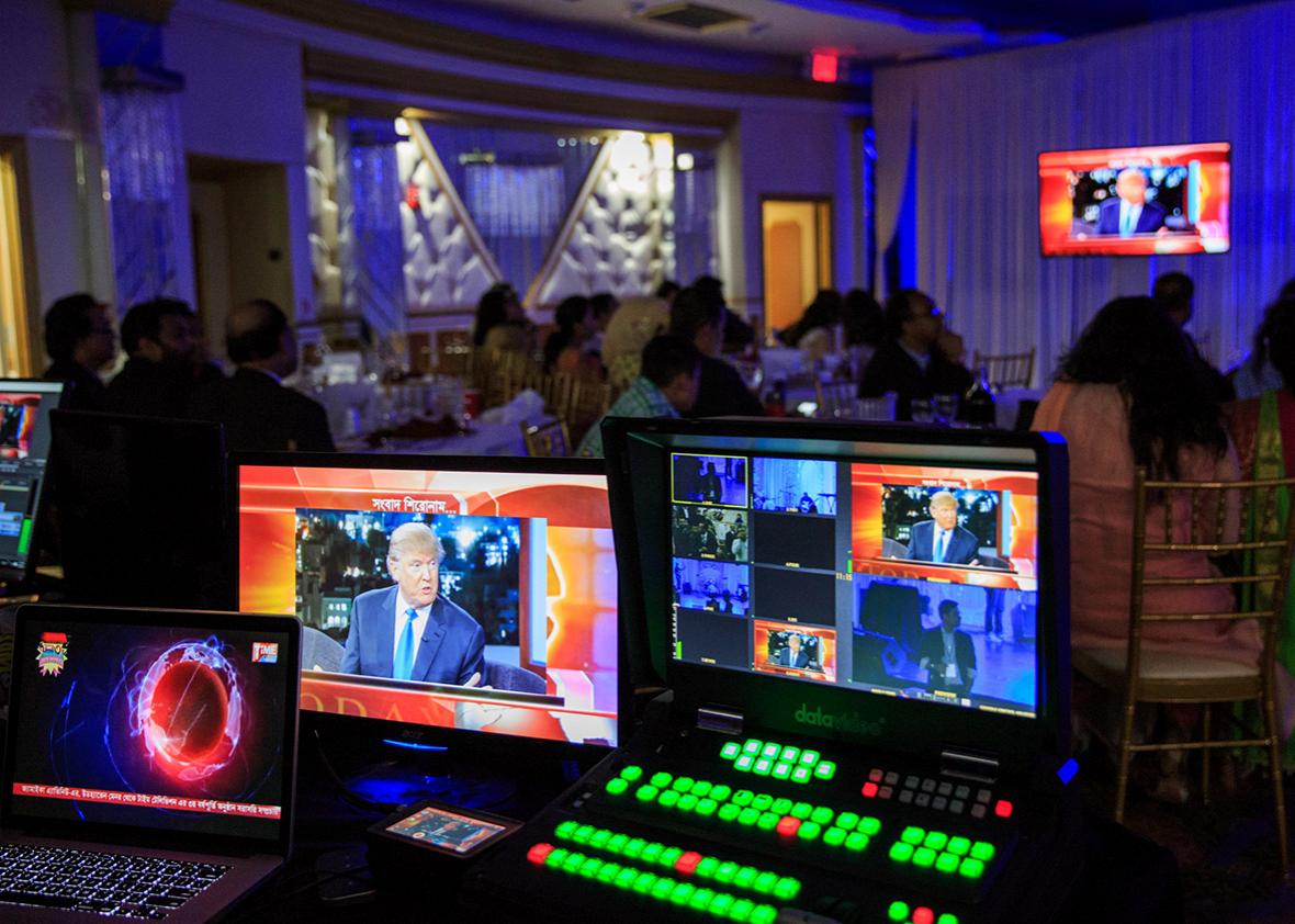 Time Television, a bilingual station catering to New York City's Bangladeshi and South Asian community, airs a live broadcast at a celebration during the presidential debates on September 26th, 2016 in Queens, New York.