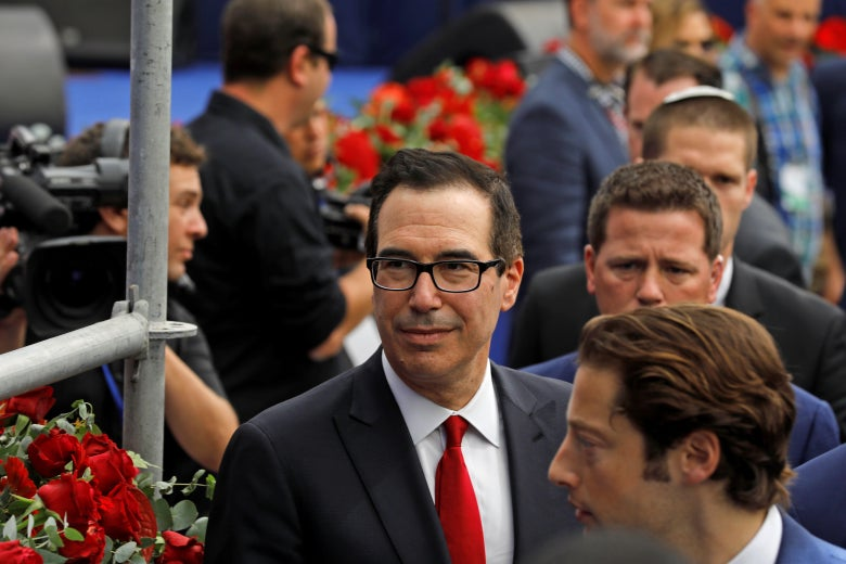 Treasury Secretary Steve Mnuchin (red tie) arrives ahead of the inauguration of the US embassy in Jerusalem on May 14, 2018.