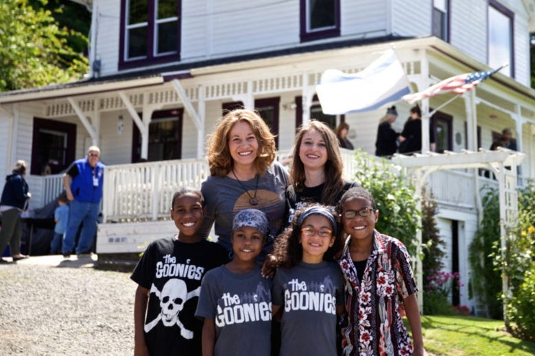"This June 2014 photo shows Devonte Hart with his family at the annual celebration of ""The Goonies"" movie in Astoria, Ore."