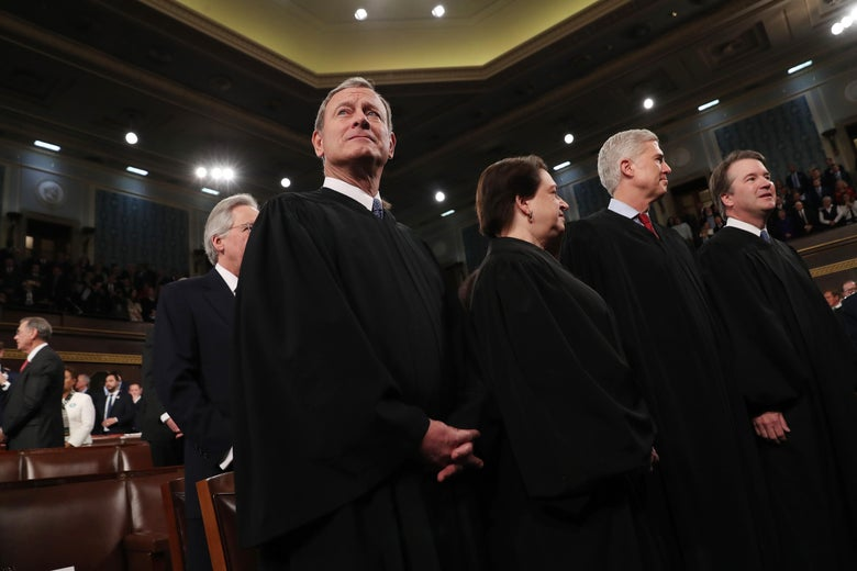 John Roberts, Elena Kagan, Neil Gorsuch, and Brett Kavanaugh stand in robes.