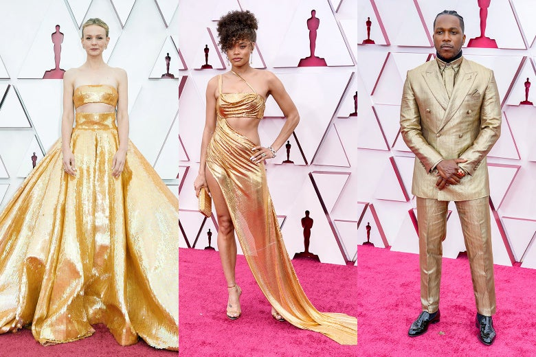 Carey Mulligan, Andra Day, and Leslie Odom Jr. pose on a red carpet.