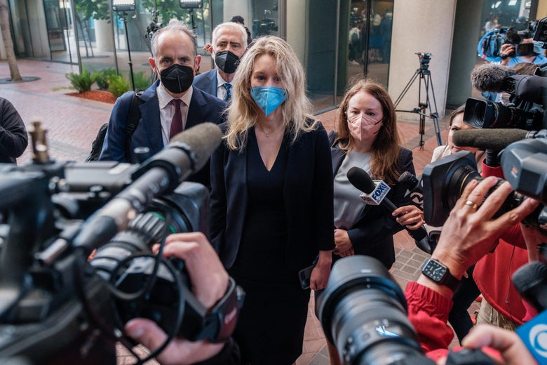Elizabeth Holmes arrives for the first day of jury selection in her fraud trial.
