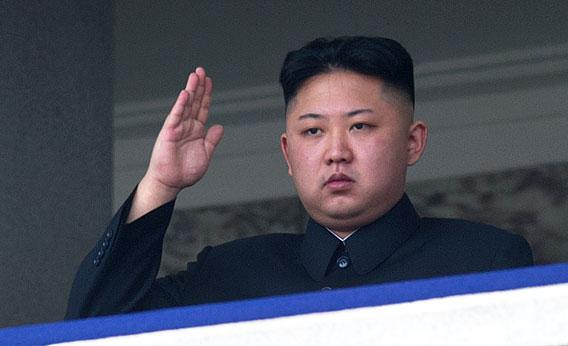North Korean leader Kim Jong-Un salutes as he watches a military parade to mark 100 years since the birth of the country's founder and his grandfather, Kim Il-Sung, in Pyongyang on April 15, 2012.