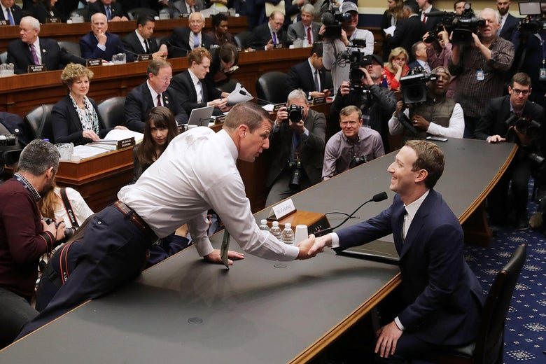 Rep. Markwayne Mullin shakes hands with Mark Zuckerberg.