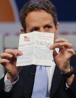 Timothy Geithner holds up a copy of the U.S. Constitution. Click to expand image.