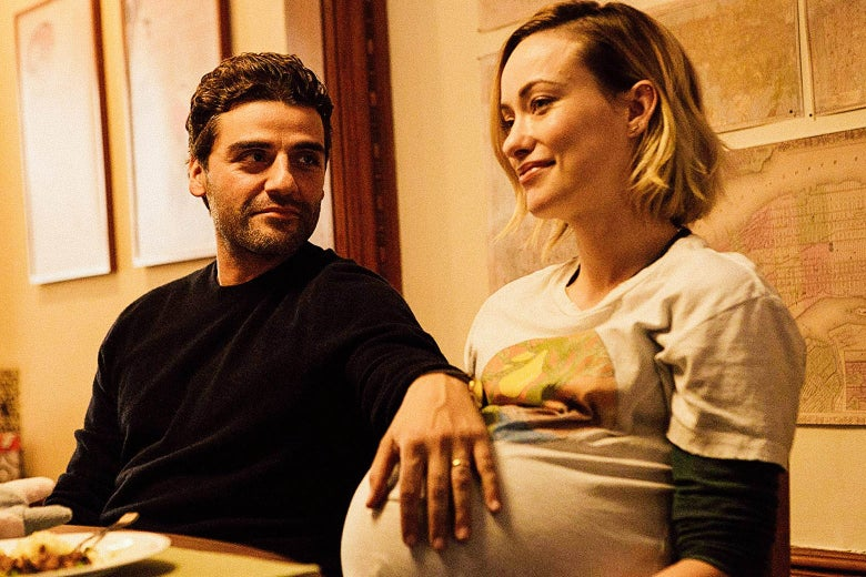 Oscar Isaac's character rests his arm on the pregnant belly of Olivia Wilde's character.