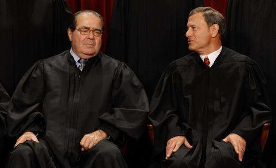 U.S. Supreme Court Associate Justice Antonin Scalia (L) and Chief Justice John Roberts talk.