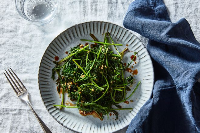 Salad greens on a white dish.