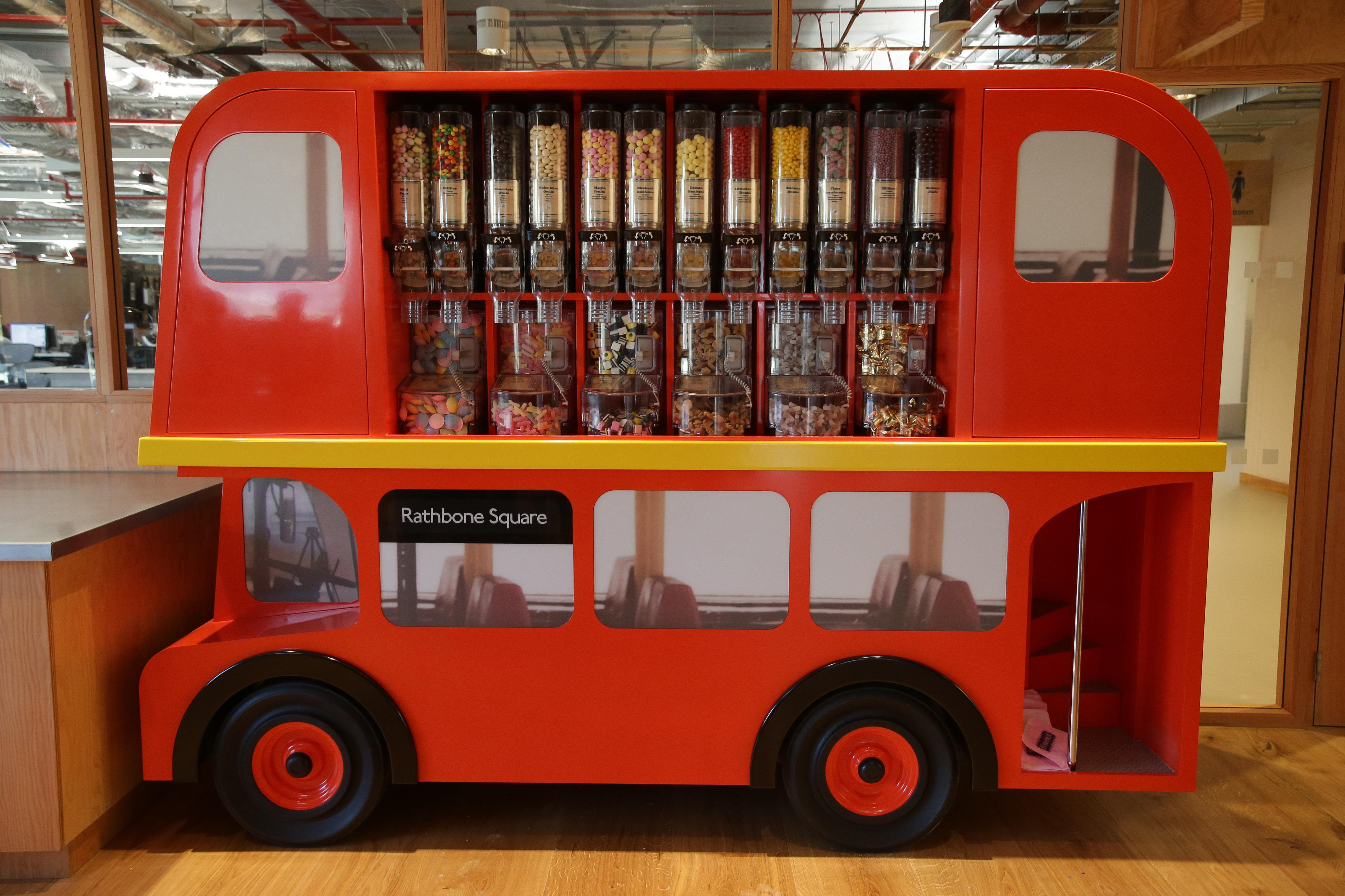 A candy dispenser decorated as a double-decker London bus is displayed at Facebook's new headquarters, designed by Canadian-born American architect Frank Gehry, at Rathbone Place in central London on December 4, 2017.         Social media titan Facebook opened a new office in London on December 4, 2017, that is set to be its biggest engineering hub outside America, the company has announced. / AFP PHOTO / Daniel LEAL-OLIVAS        (Photo credit should read DANIEL LEAL-OLIVAS/AFP/Getty Images)