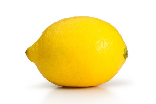 Stock art of a single lemon on a white background.